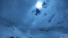 Night Sky Time Lapse With Old Wood Cabin and Ice Hotel in winter scene Stock Footage