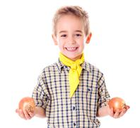 Little agriculturist holding onions Stock Photos