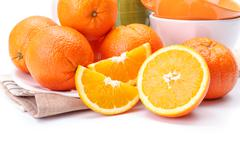 Appetizing oranges on plate Stock Photos