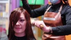 Stretching And Straightening Hair Dryer Stock Footage