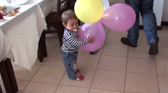 Small child with air balls Stock Footage