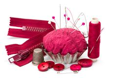 Sewing accessories: thread, needle, thimble and pincushion - stock photo