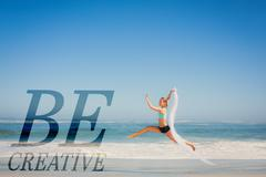 Stock Illustration of Composite image of fit woman jumping gracefully on the beach with scarf