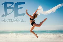 Stock Illustration of Composite image of fit blonde jumping gracefully with scarf on the beach