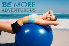 Composite image of fit woman lying on exercise ball at the beach stretching - stock illustration
