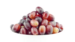 Grape disappears from white bowl, stop motion Stock Footage