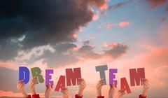 Stock Illustration of Composite image of hands holding up dream team