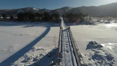 4K Aerial Stock Footage Flight Above Old Bridge in Winter Sunrise Stock Footage