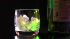 Whiskey bottle and glass Stock Footage