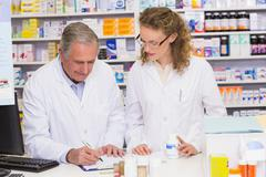 Stock Photo of Team of pharmacist looking a medication for a prescription
