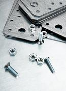 Metal preparations and fixing elements on the scratched metal background. - stock photo