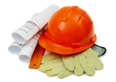 Drawings for building house, helmet and other working tools. - stock photo