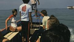 Thailand 1978: european tourists in a boat trip in the Ocean Stock Footage