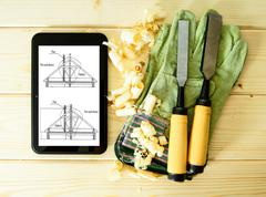 Planning of construction of the house. Joiner's works. Woodworking. Tablet, d - stock photo