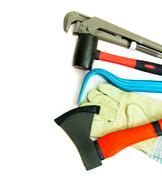 Many working tools - axe, glove and others on white background. - stock photo