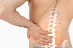 Stock Illustration of Highlighted spine pain of man