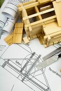 Joiner's works. Drawings for building, working tools and small wooden house. - stock photo