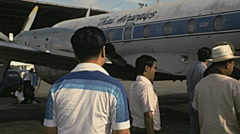 Thailand 1978: passenger entering into a Thai airways aircraft - stock footage