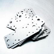 Metal preparations and fixing elements on the scratched metal background. Stock Photos
