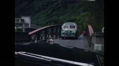 Car Waits to Cross One Lane Bridge 1957 Stock Footage