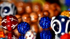 Top of brilliant, shiny, beautiful beads on white background, rotation, close up - stock footage