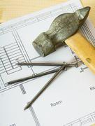 Repair work. Drawings for building and working tools on wooden background. - stock photo