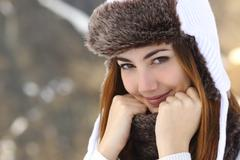 Beauty woman face portrait warmly clothed in winter Stock Photos