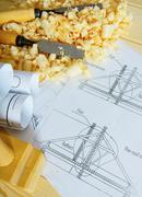 Woodworking. Drawings for building and working tools on wooden background. - stock photo