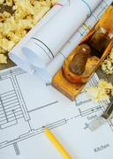 Joiner's works. Drawings for building and working tools on wooden background. Stock Photos