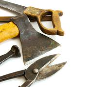 Vintage working tools ( axe, saw and others) on white background. - stock photo