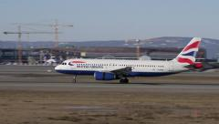 British Airways Airbus landing at Oslo Airport - stock footage