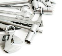 Metalwork. Spanner , ruler, caliper and others tools on white background. - stock photo