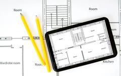 Tablet, drawings and working tools. - stock photo