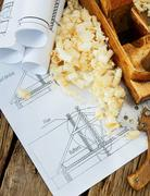 Joiner's works. Drawings for building and working tools on wooden background. - stock photo