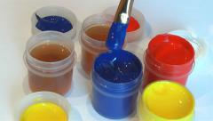 Artist dips the brush into the paint Stock Footage