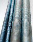 Metal hairpins on the scratched metal background. - stock photo