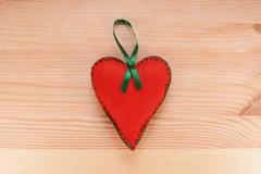 Red felt heart ornament with green ribbon Stock Photos