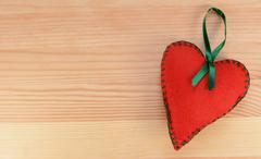 Heart-shaped felt decoration with green ribbon Stock Photos