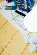 Stock Photo of House planning. Repair work. Drawings for building, mount, gloves and others
