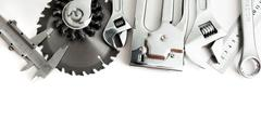 Metalwork. Stapler, saw, wrench and others tools on white background. - stock photo