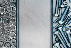 Hairpin and other fixing elements on the scratched metal background. Stock Photos