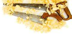 Joiner's works. Wooden shaving and saw on white background. - stock photo