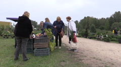 People buy apple, plum, nut and other ecologic food from farmer Stock Footage