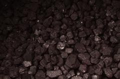 Pile of brown coal texture - stock photo