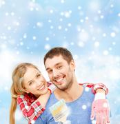 Smiling couple with paintbrush Stock Photos