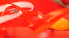 Measuring tape and ribbons isolated on red cloth - stock footage