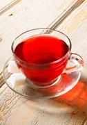 Garnet tea on a wooden board. - stock photo