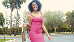 Sexy African American woman walking away with shopping bags Stock Footage