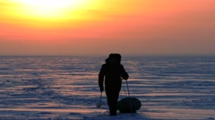 4K Stock Footage Lone Traveler in the Icy Wilderness Talking By Radio - stock footage