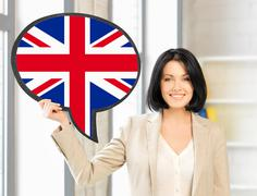 smiling woman with text bubble of british flag - stock photo